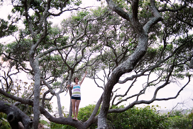 Woman in a tree in Grayton Beach State Park.