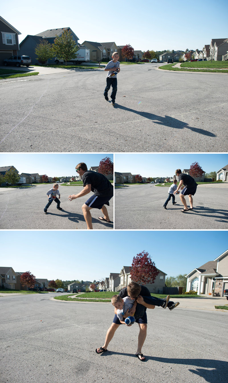 boy and his dad playing football in the cul-de-sac