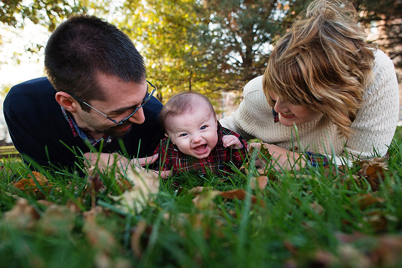 Cute family portrait lying in the grass.