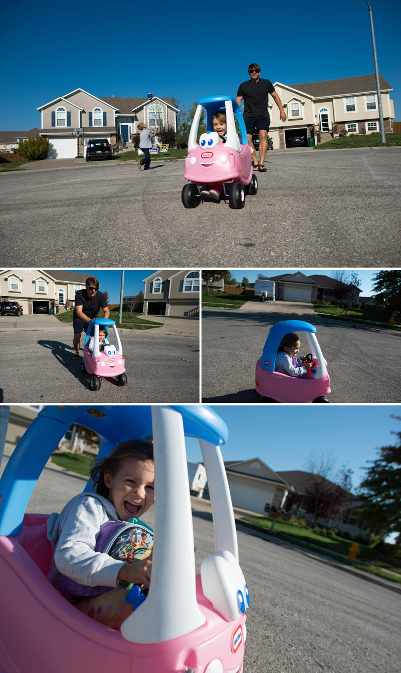 preschooler playing in little tykes car