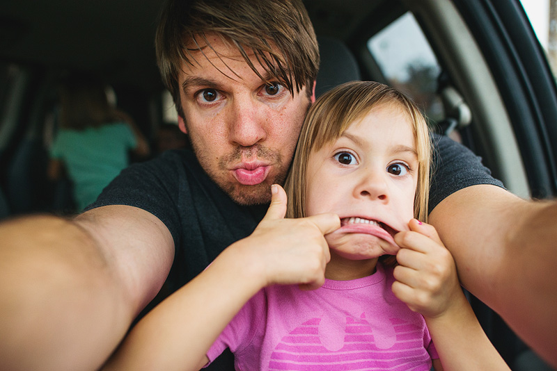 Father daughter silly face portrait.