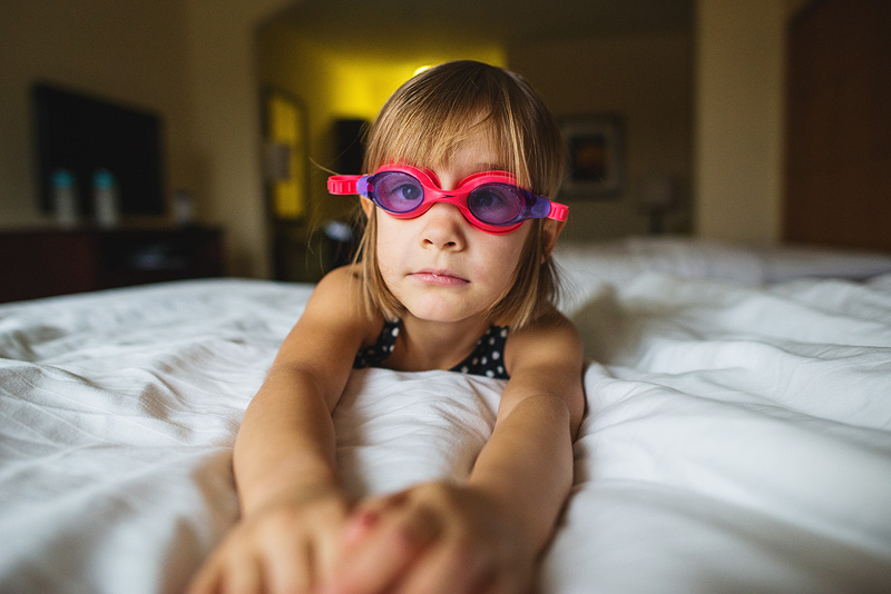 Girl with goggles waiting to swim.