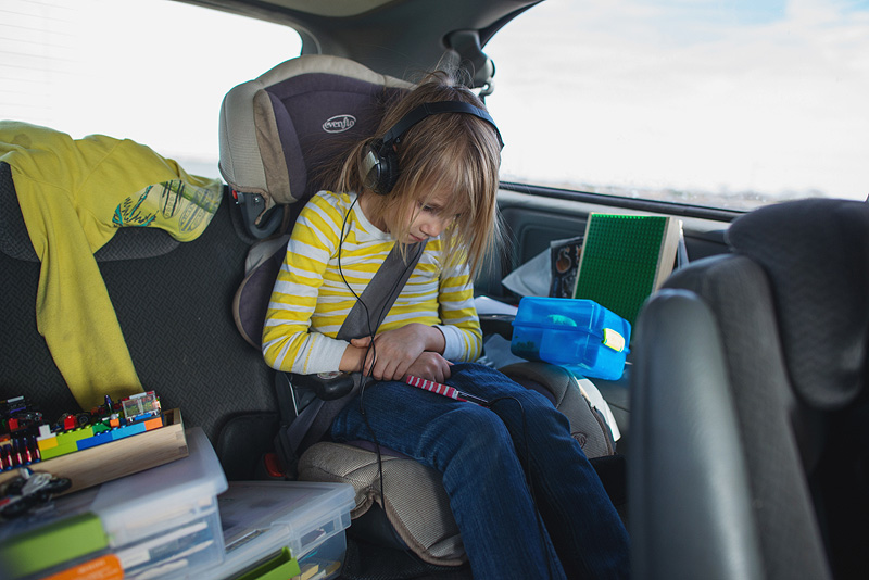 Girl meditating with Brainwave app in the car.