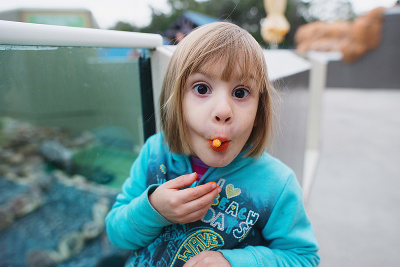 Girl eating cheetos.