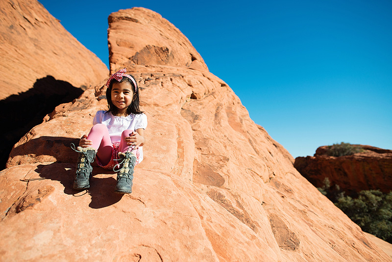 Girl having fun climbing in Red Rock Canyon.