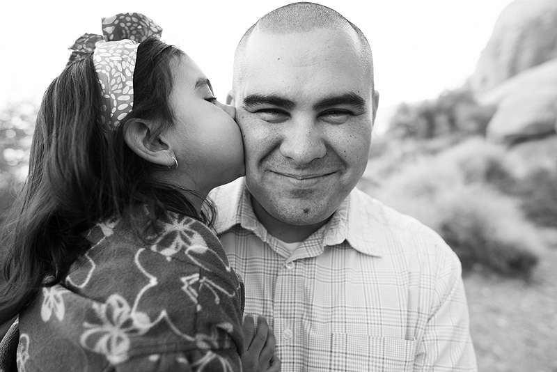 Daughter kissing her dad.
