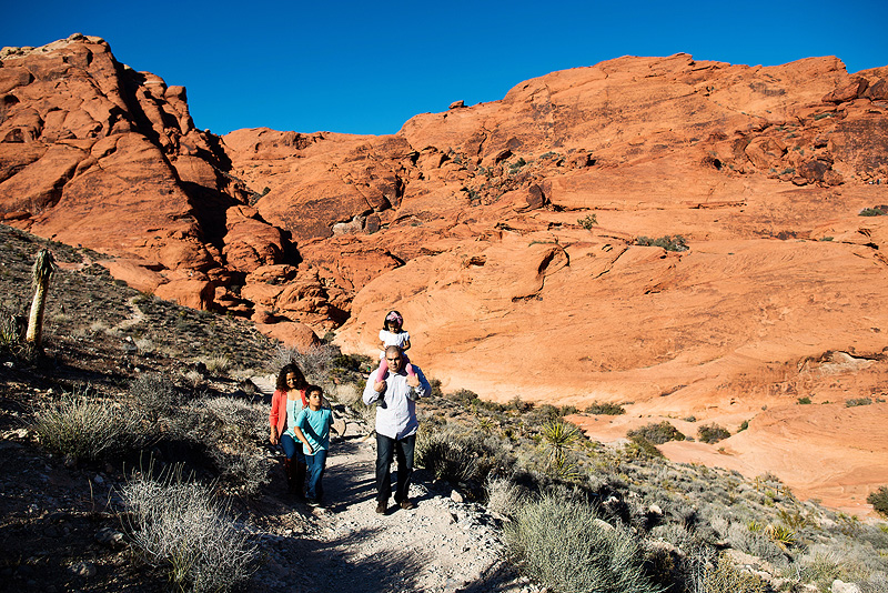Family hiking together in Red Rock canyon.
