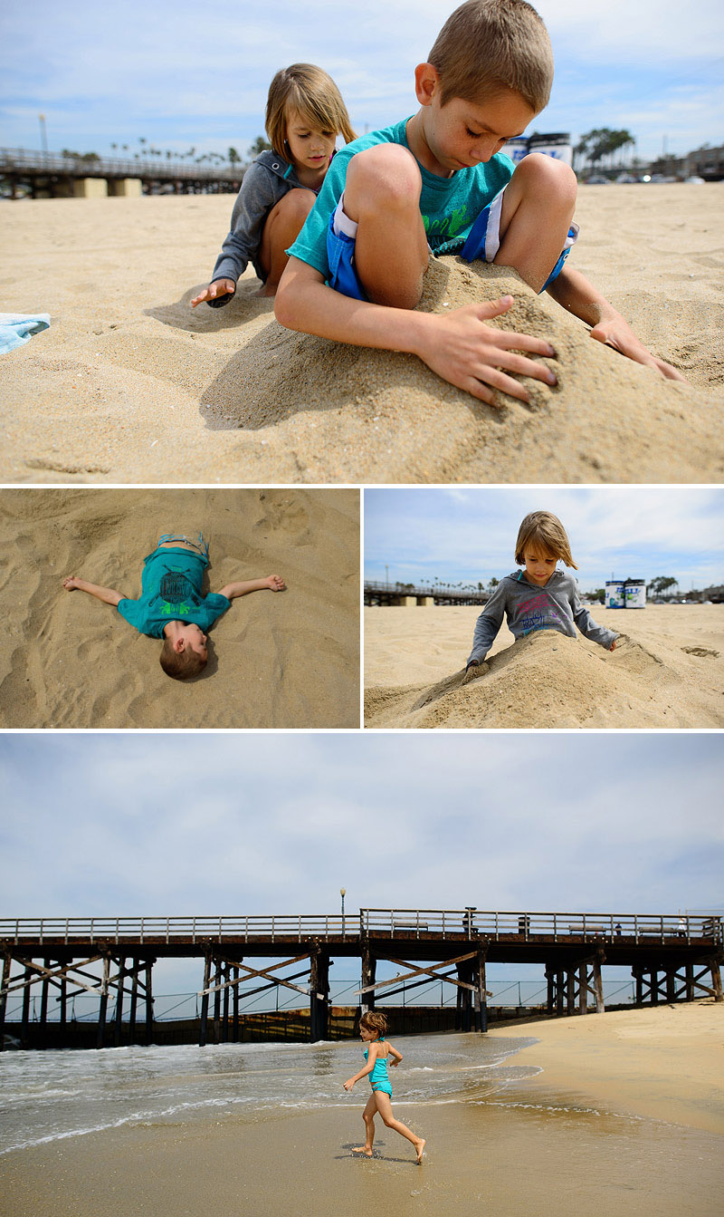 kids burying themselves in the sand