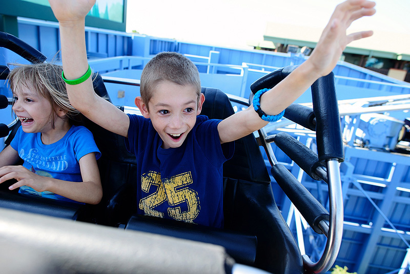 kids riding goofy's sky school roller coaster at california adventure