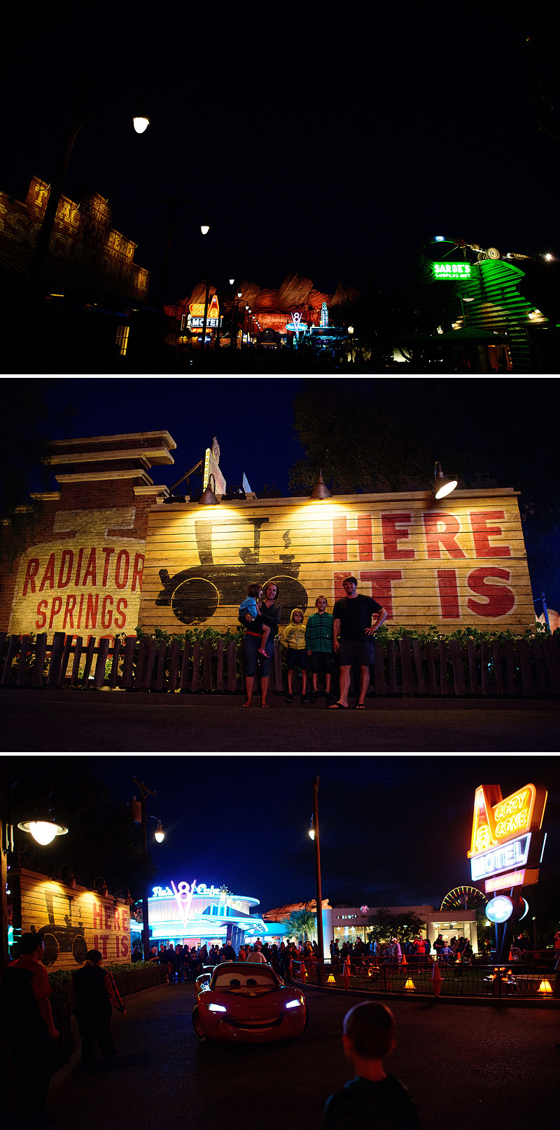 cars land lit up at night with neon signs