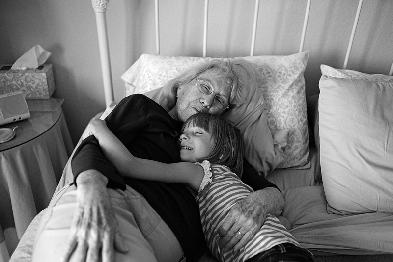Great grandma snuggling her grandaughter.