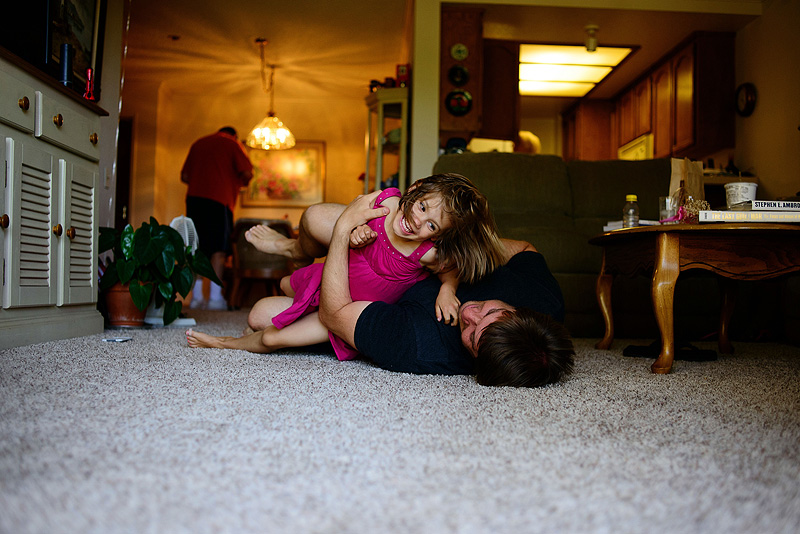 Happy family tickle fights.