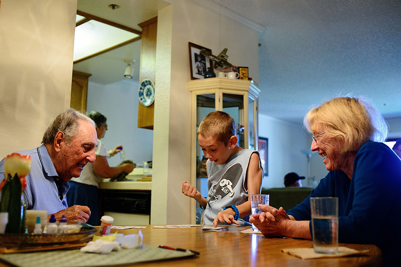 Grandparents playing war with their great grandkid.