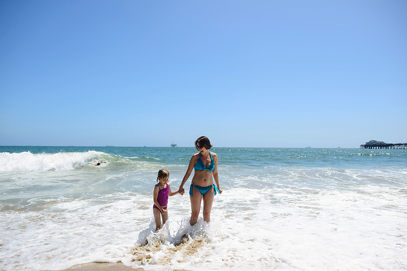 Mom and daughter playing in Seal Beach.
