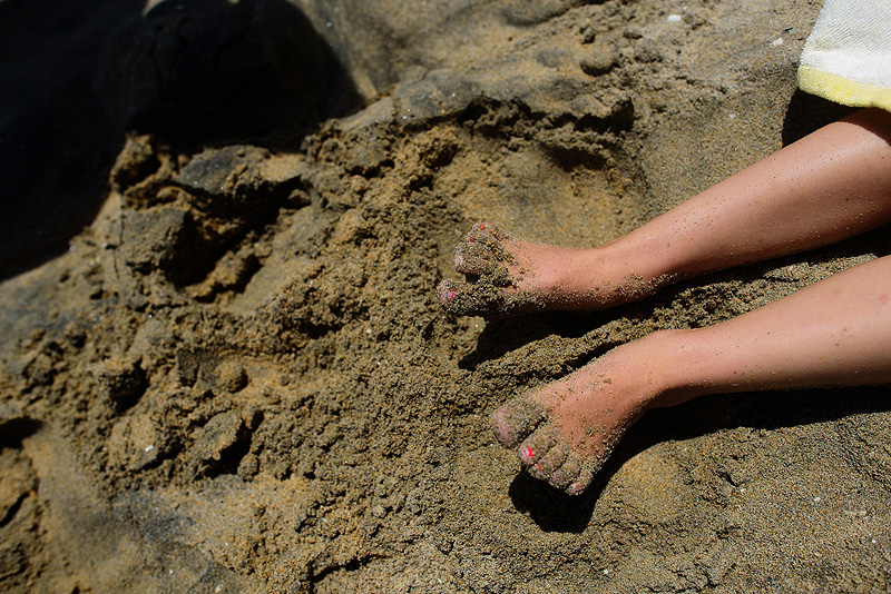 Sandy toes.