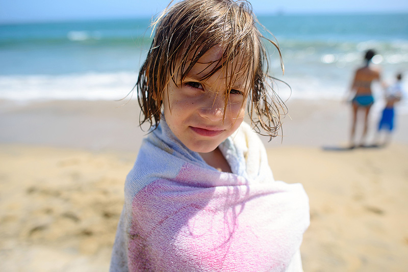 Girl with sand in her hair.