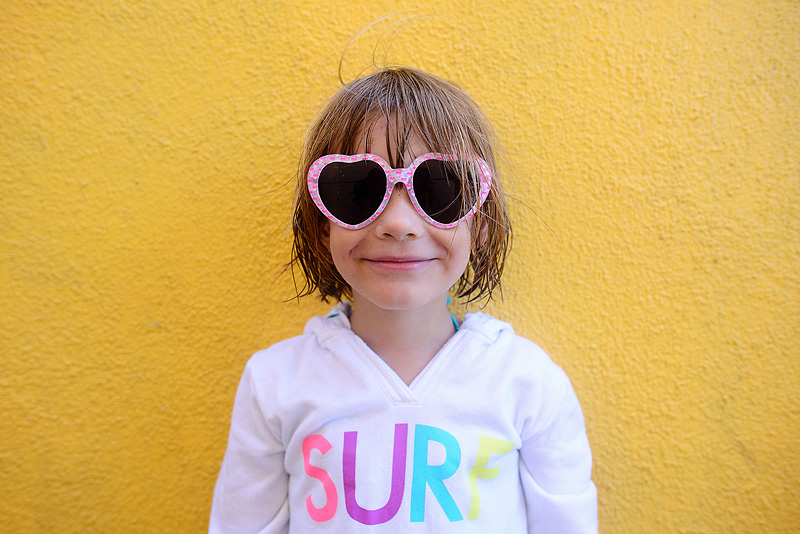 Cute girl with heart sunglasses.