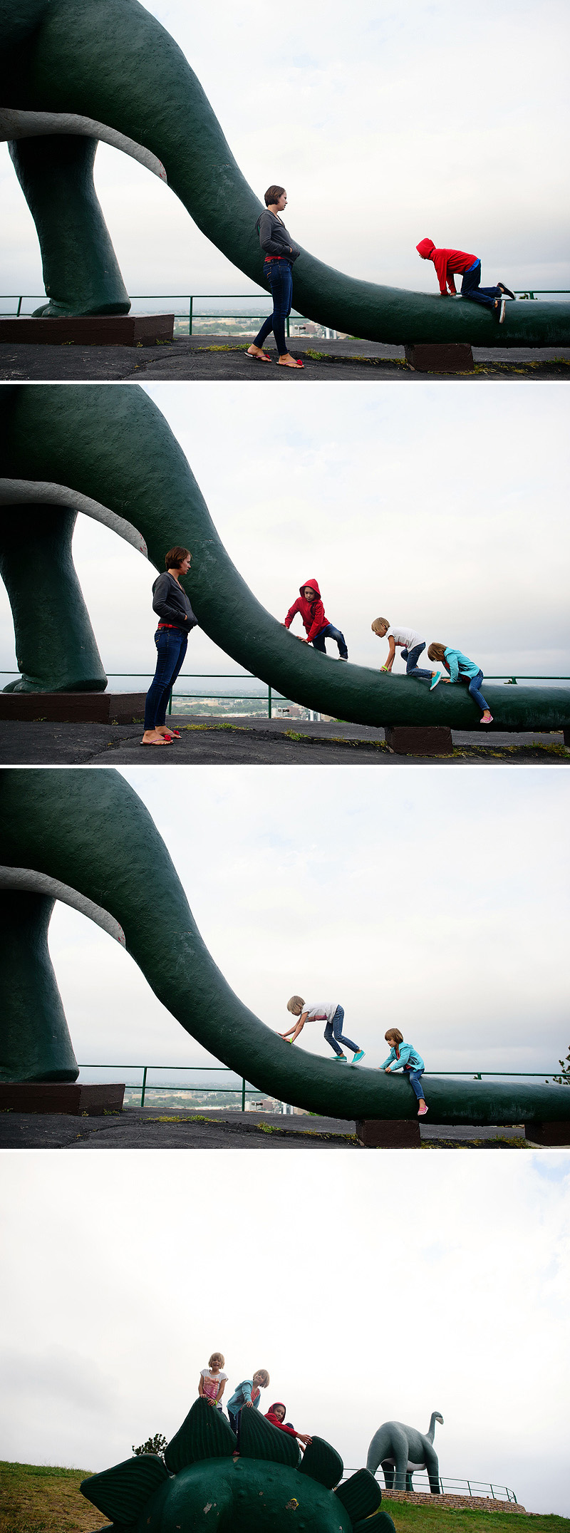 kids climbing on dinosaur statues