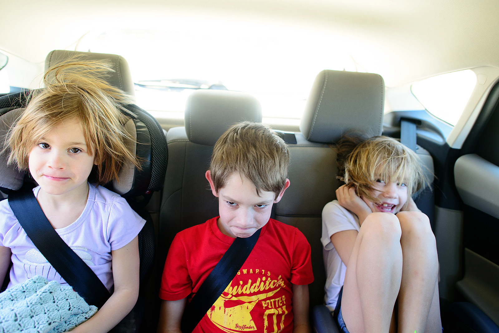 kids in a ford focus on the way to Disney World