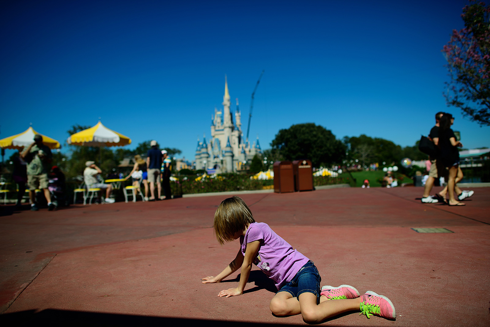 girl with Cinderella's Castle