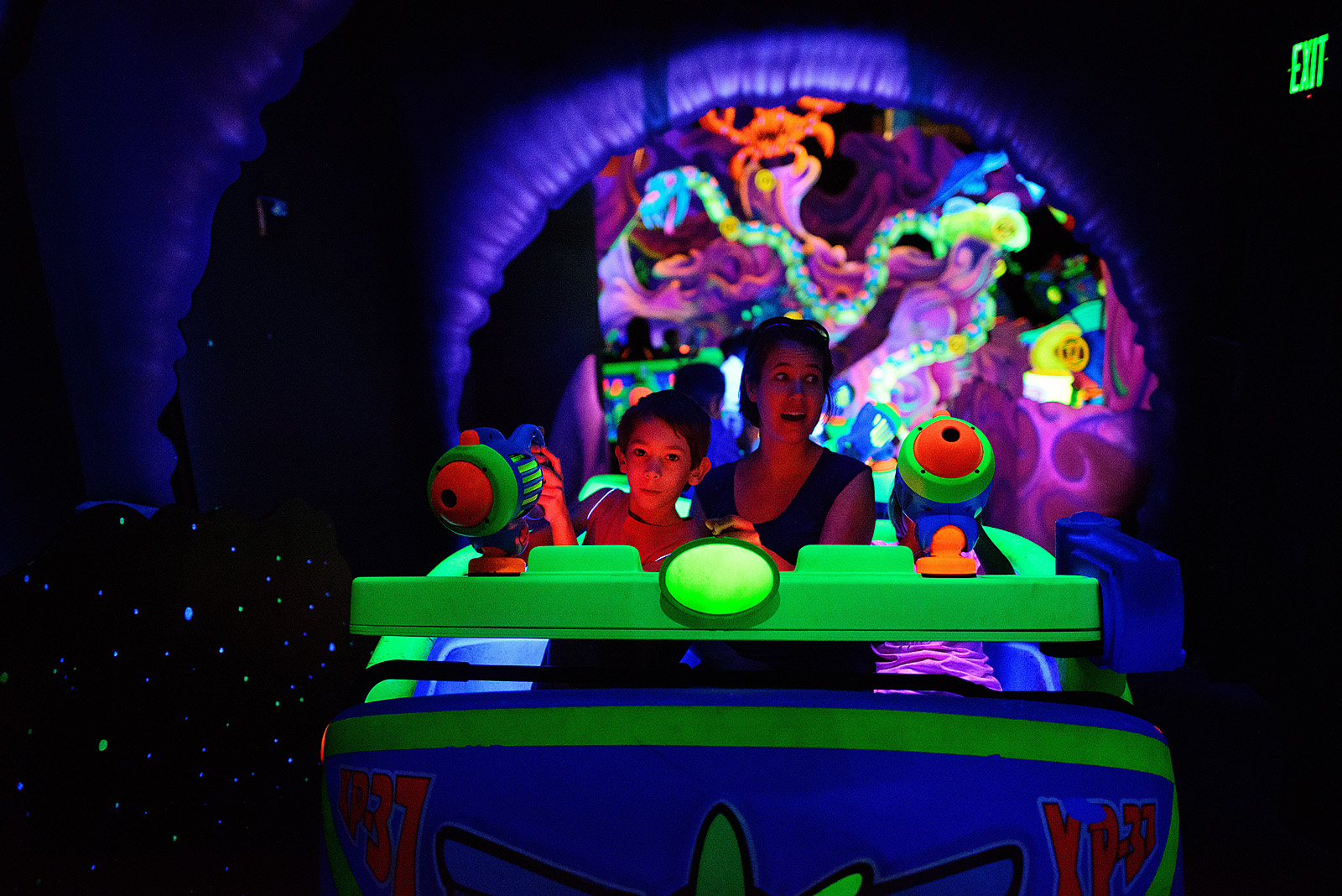 mom and son on buzz lightyear's space ranger spin at magic kingdom