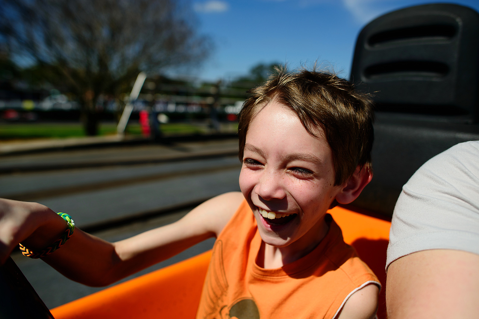 boy driving the tomorrowland speedway car and having an incredible time