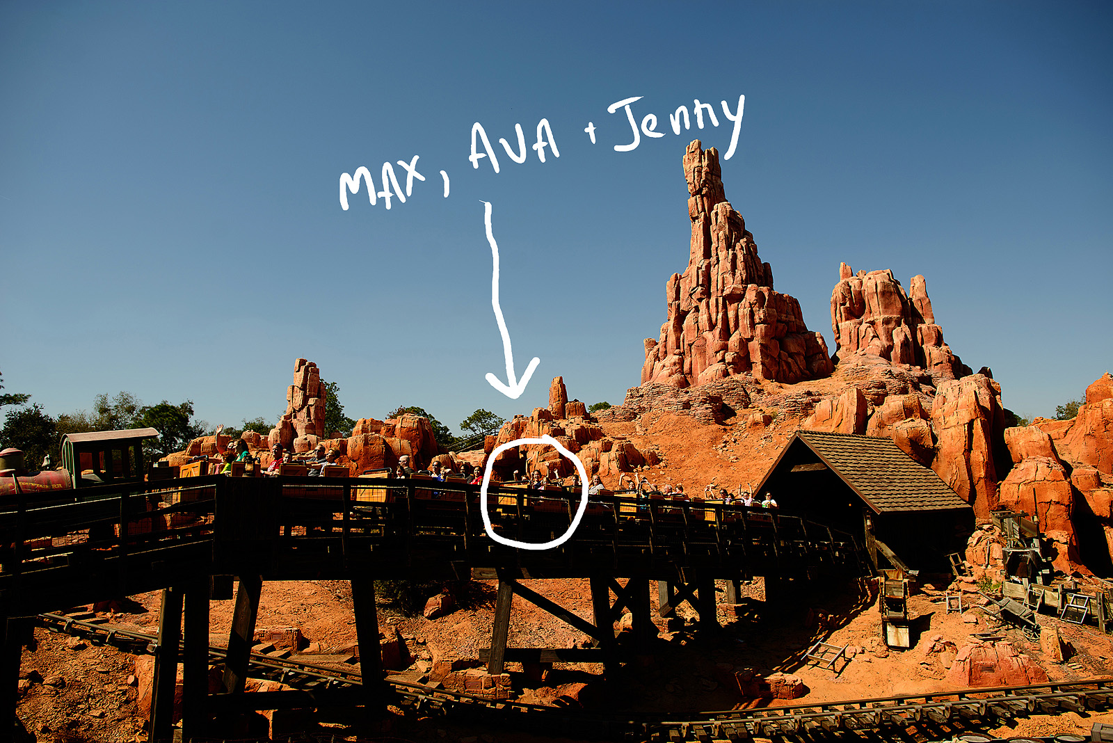 family riding Big Thunder Mountain awesome roller coaster at Disney World