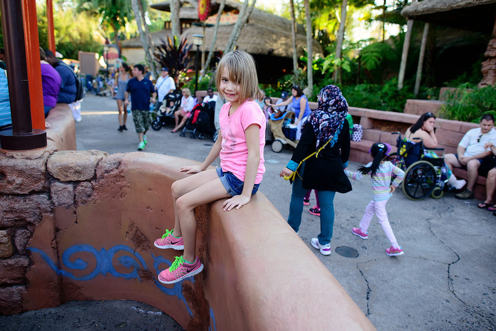 girl waiting in line for ride at disney world