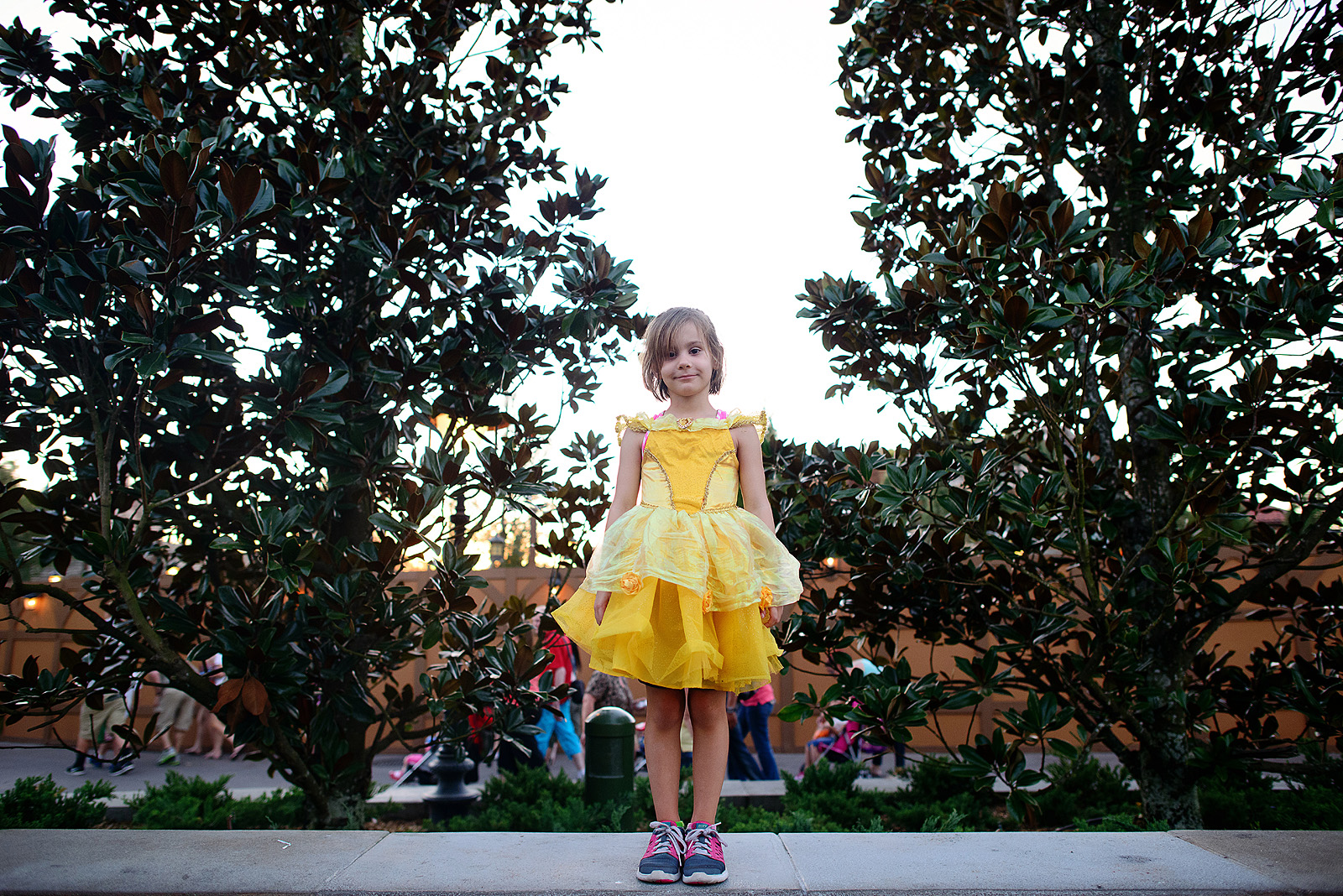 little girl dressed up as princess belle at disney world