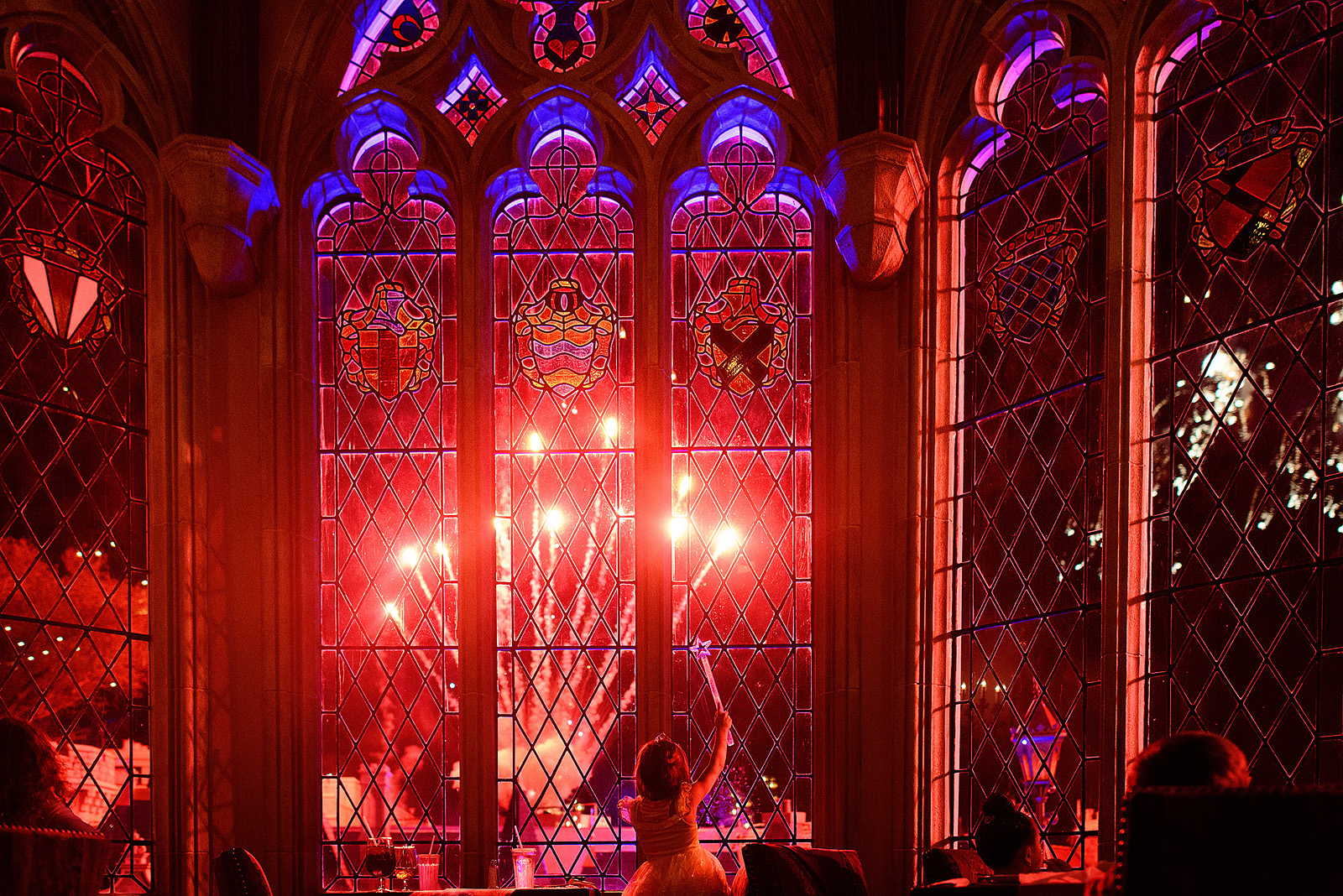 little princess watching the fireworks from inside Cinderella's castle at Magic Kingdom Disney World