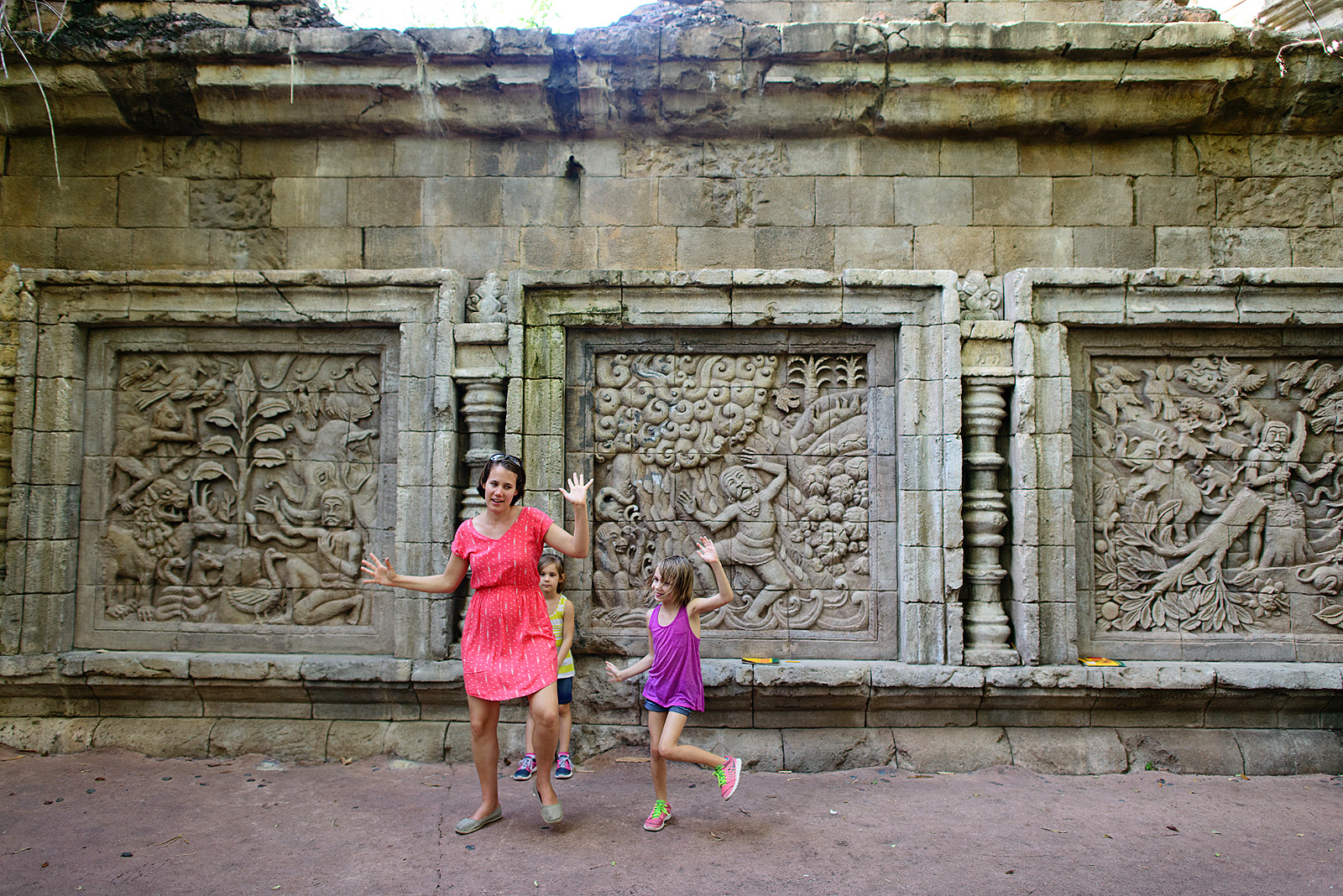 silly family dancing at animal kingdom